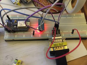 Breadboard prototype of a very cheap WiFi to RS232 adaptor.